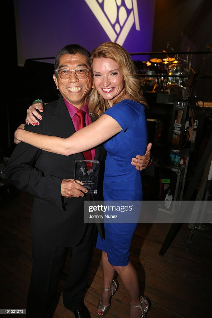 Fashion designer and honoree Tadashi Shoji and actress Andrea Powell attend the 16th Annual Samuel Waxman Cancer Research Foundation Collaborating For A Cure Benefit Dinner & Auction at Park Avenue Armory on November 21, 2013 in New York City.