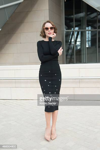 Fashion Designer and Photographer Ulyana Sergeenko wears a Ulyana Sergeenko dress Christian Louboutin shoes and Sonia Rykiel sunglasses on day 9 of...