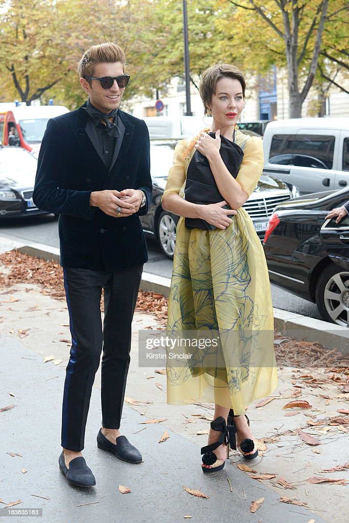 Fashion designer and photographer Ulyanna Sergeenko wearing her own design dress with Prada shoes and bag and Marketing director Frol Burimskiy wearing a Balenciaga shirt and trousers and Lanvin jacket and shoes on day 9 of Paris Fashion Week Spring/Summer 2014, Paris October 02, 2013 in Paris, France.