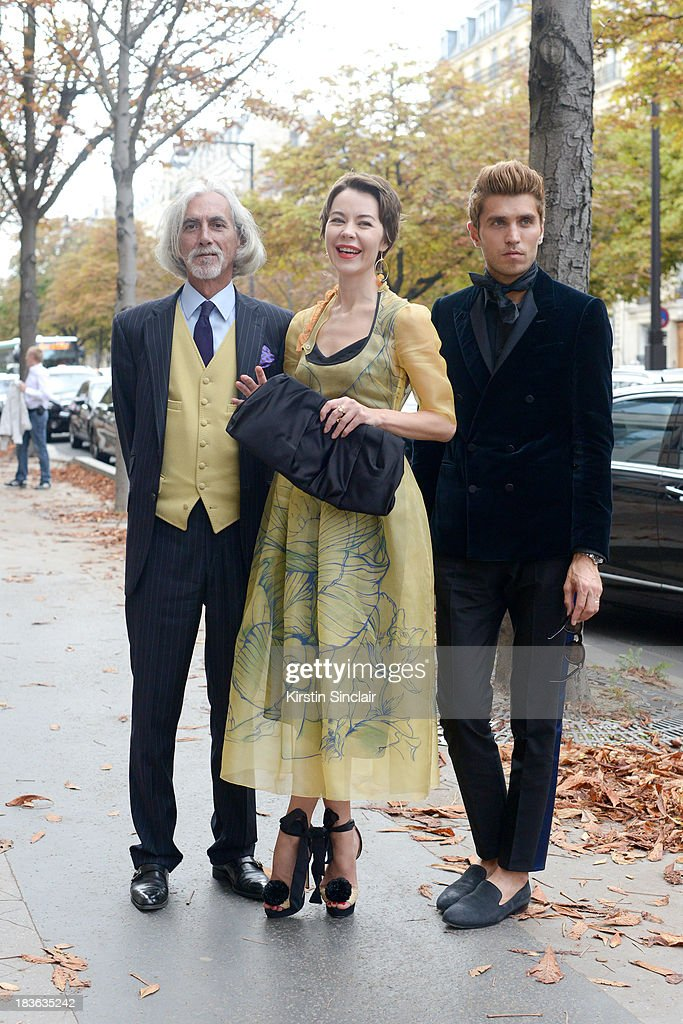 Fashion designer and photographer Ulyanna Sergeenko wearing her own design dress with Prada shoes and bag, Antonio Joaquim and Marketing director Frol Burimskiy wearing a Balenciaga shirt and trousers and Lanvin jacket and shoes on day 9 of Paris Fashion Week Spring/Summer 2014, Paris October 02, 2013 in Paris, France.