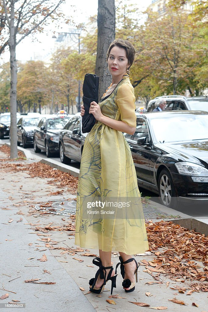 Fashion designer and photographer Ulyanna Sergeenko wearing her own design dress with Prada shoes and bag on day 9 of Paris Fashion Week Spring/Summer 2014, Paris October 02, 2013 in Paris, France.