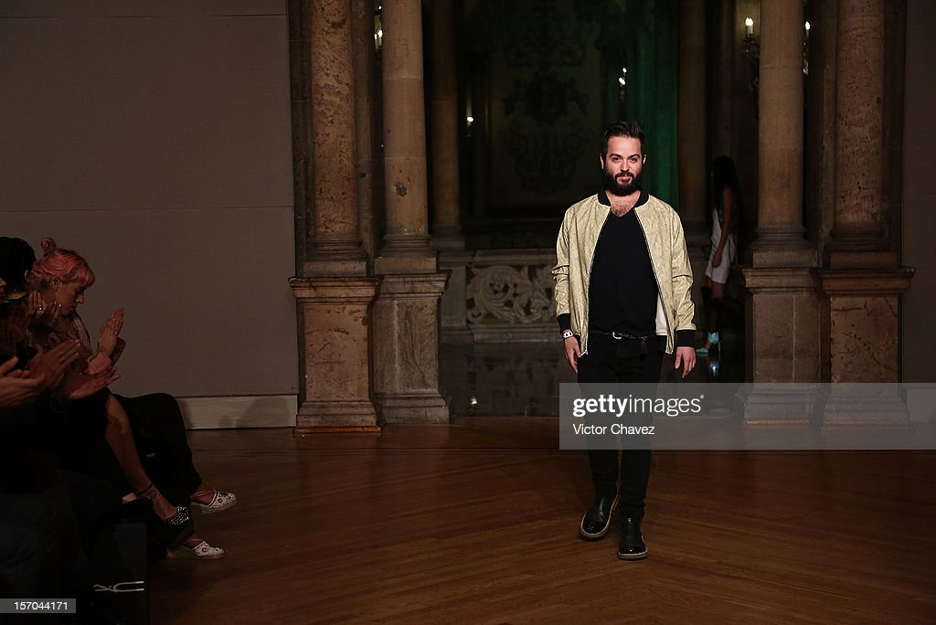 Fashion designer <a gi-track='captionPersonalityLinkClicked' href=/galleries/search?phrase=Andres+Jimenez&family=editorial&specificpeople=5498155 ng-click='$event.stopPropagation()'>Andres Jimenez</a> walks the runway during the Mancandy Spring/Summer 2013 fashion show at Casino Español on November 27, 2012 in Mexico City, Mexico.