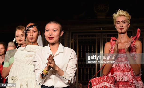Fashion designer Angel Chen on the runway after her show at Fashion Scout during London Fashion Week Spring/Summer collections 2017 on September 16...