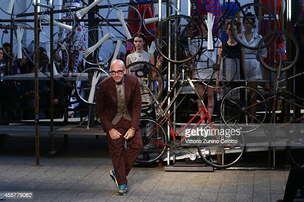 Fashion designer Antonio Marras acknowledges after the Antonio Marras Show as part of Milan Fashion Week Womenswear Spring/Summer 2015 on September...