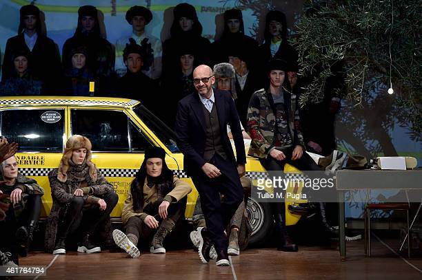 Fashion designer Antonio Marras acknowledges the applause of the audience after the Antonio Marras as a part of Milan Menswear Fashion Week Fall...