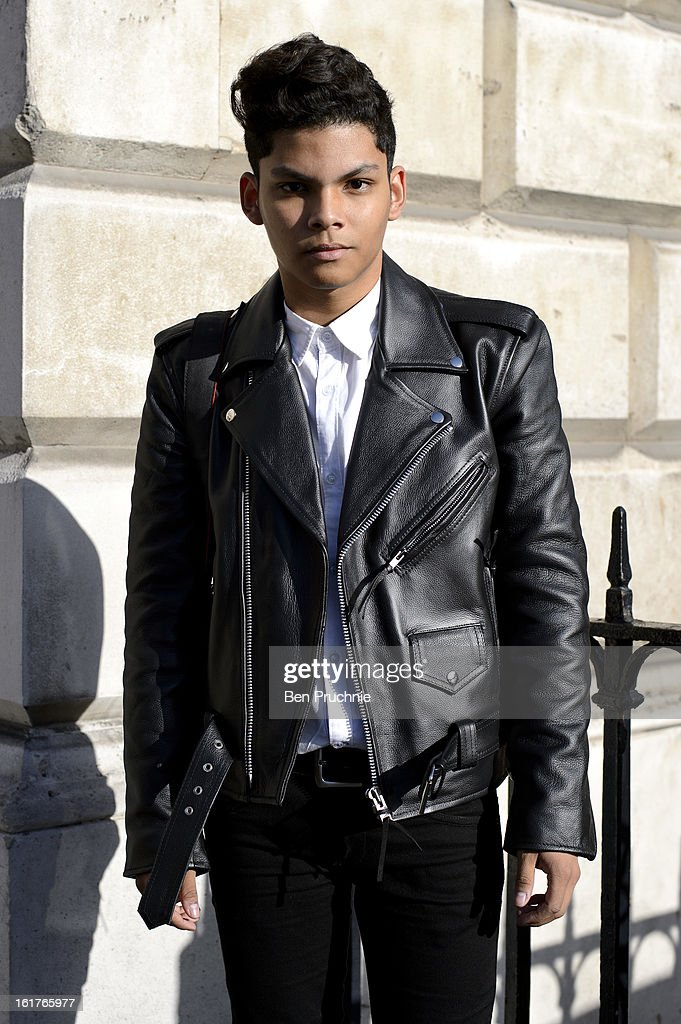 Fashion designer Antonio (19) poses wearing a vintage leather jacket with Zara jeans and shirt with Doc Martin boots outside the Zoe Jordan London Fashion Week F/W 2013 presentation at Somerset House on February 15, 2013 in London, England.