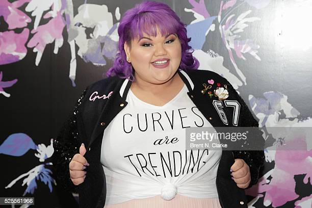 Fashion designer Ashley Nell Tipton of 'Project Runway' poses for photographs during the launch of her Boutique clothing line at JCPenney on April 28...