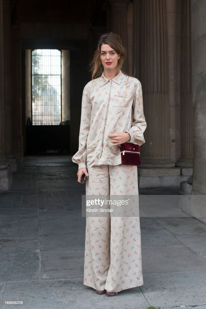 Fashion designer at T180 Antonine Peduzzi wearing a Louis Vuitton trouser suit and bag and T180 shoes on day 9 of Paris Fashion Week Spring/Summer 2014, Paris October 02, 2013 in Paris, France.
