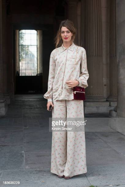 Fashion designer at T180 Antonine Peduzzi wearing a Louis Vuitton trouser suit and bag and T180 shoes on day 9 of Paris Fashion Week Spring/Summer...
