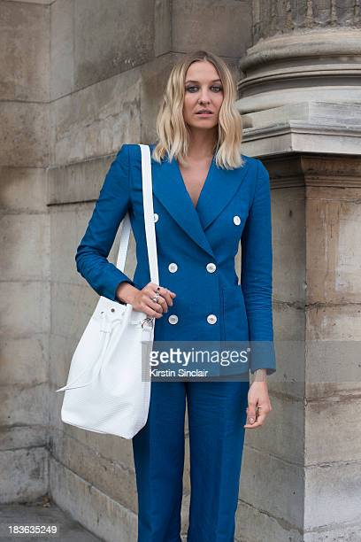 Fashion designer at T180 Luisa Orsini wears a Louis Vuitton suit and a T180 bag on day 9 of Paris Fashion Week Spring/Summer 2014 Paris October 02...