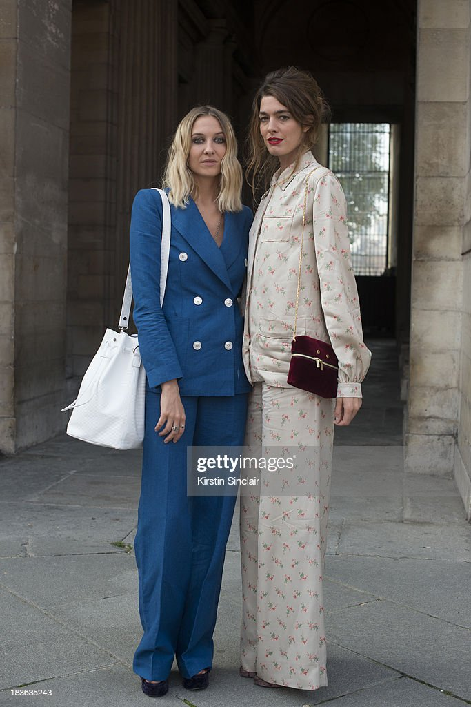 Fashion designer at T180 Luisa Orsini wears a Louis Vuitton suit Oz shoes and a T180 bag and Fashion designer at T180 Antonine Peduzzi wearing a Louis Vuitton trouser suit and bag and T180 shoes on day 9 of Paris Fashion Week Spring/Summer 2014, Paris October 02, 2013 in Paris, France.