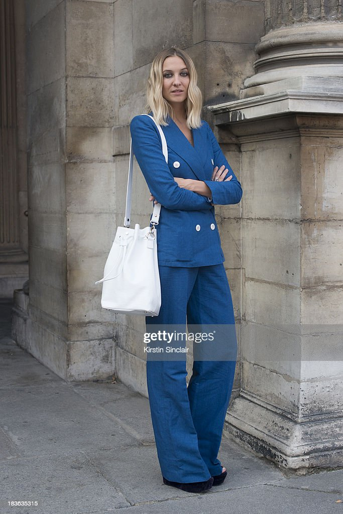 Fashion designer at T180 Luisa Orsini wears a Louis Vuitton suit Oz shoes and a T180 bag on day 9 of Paris Fashion Week Spring/Summer 2014, Paris October 02, 2013 in Paris, France.