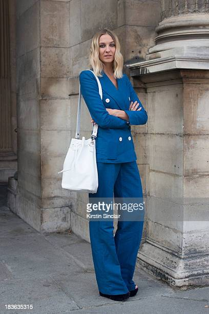 Fashion designer at T180 Luisa Orsini wears a Louis Vuitton suit Oz shoes and a T180 bag on day 9 of Paris Fashion Week Spring/Summer 2014 Paris...