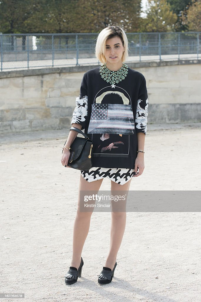 Fashion Designer at The Kooples Anne- Catherine Frey wears a Givenchy top, Balenciaga shorts, Zara shoes, Todds bag and a vintage necklace on day 5 of Paris Fashion Week Spring/Summer 2014, Paris September 28, 2013 in Paris, France.
