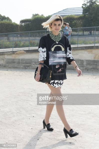 Fashion Designer at The Kooples Anne Catherine Frey wears a Givenchy top Balenciaga shorts Zara shoes Todds bag and a vintage necklace on day 5 of...
