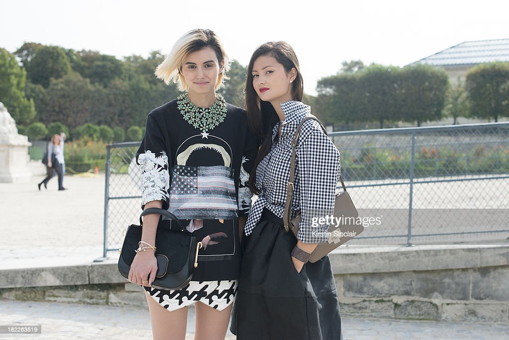 Fashion Designer at The Kooples Anne- Catherine Frey wears Givenchy top, Balenciaga shorts, Todds bag and a vintage necklace and Fashion Designer with fashion blogger Peony Lim who wears a Thomas Pink shirt, Golden Goose skirt and Jimmy Choo bag on day 5 of Paris Fashion Week Spring/Summer 2014, Paris September 28, 2013 in Paris, France.