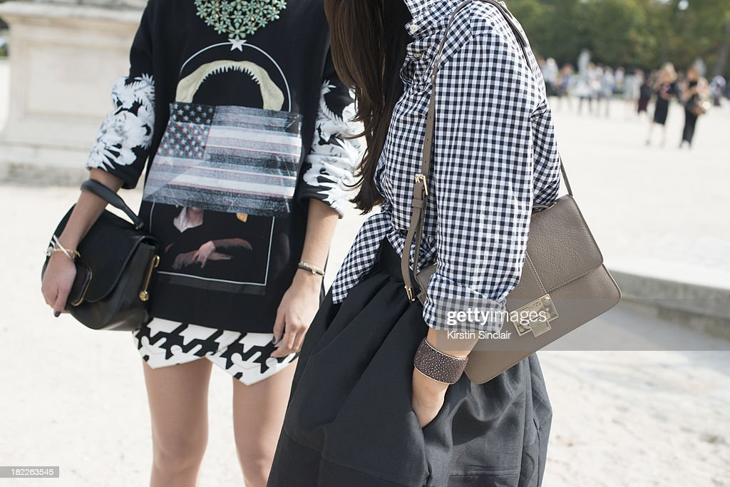 Fashion Designer at The Kooples Anne- Catherine Frey wears Givenchy top, Balenciaga shorts,Todds bag and Fashion Designer with fashion blogger Peony Lim who wears a Thomas Pink shirt, Golden Goose skirt and Jimmy Choo bag on day 5 of Paris Fashion Week Spring/Summer 2014, Paris September 28, 2013 in Paris, France.