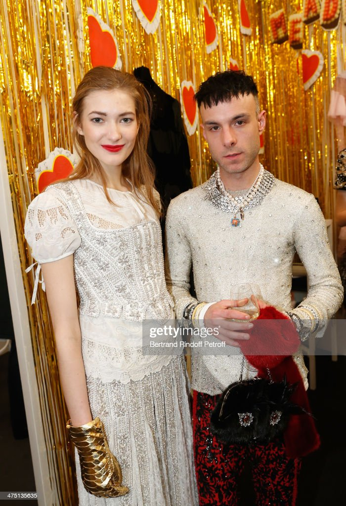 Fashion designer Benjamin Kirchhoff (R) from label Meadham Kirchhoff and a model attend LVMH Prize Semi-Finalists Designers Cocktail Party on February 26, 2014 in Paris, France.
