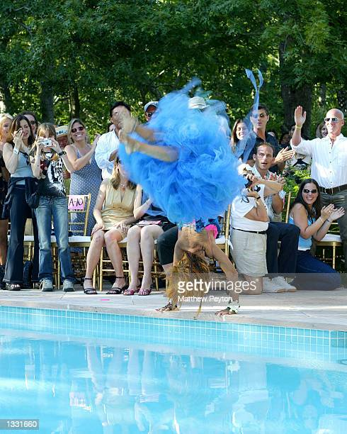 Fashion designer Betsey Johnson backflips into a pool to conclude her spring/summer 2003 fashion show at her 60th birthday party in her East Hampton...