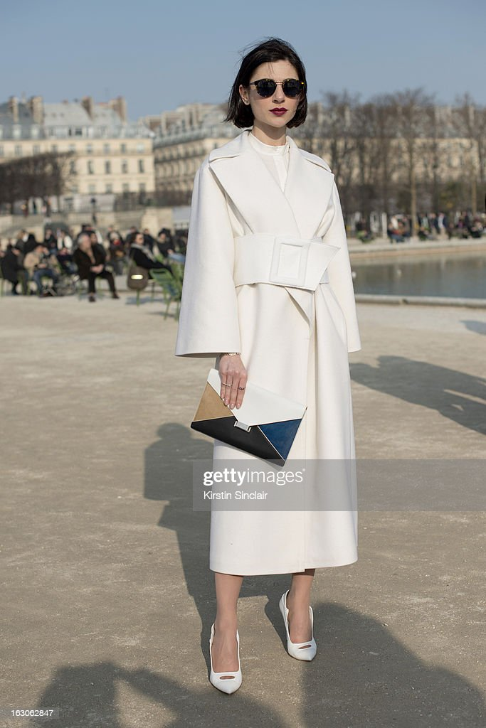 Fashion designer Bibi Bevza wears a Bevza coat and shoes, Celine bag and Retro Super Future sunglasses on day 4 of Paris Womens Fashion Week Autumn/Winter 2013 on March 03, 2013 in Paris, France.