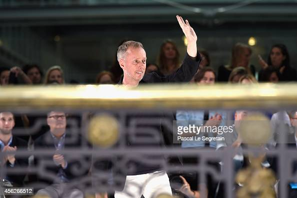 Fashion designer Bill Gaytten acknowledges the applause of the audience after the John Galliano show as part of the Paris Fashion Week Womenswear...