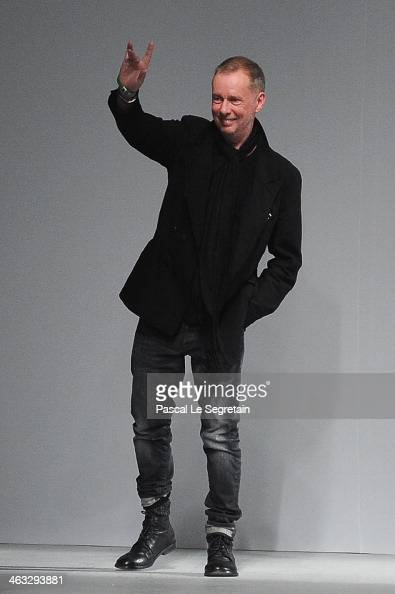 Fashion designer Bill Gaytten acknowledges the applause of the audience after the John Galliano Menswear Fall/Winter 20142015 show as part of Paris...