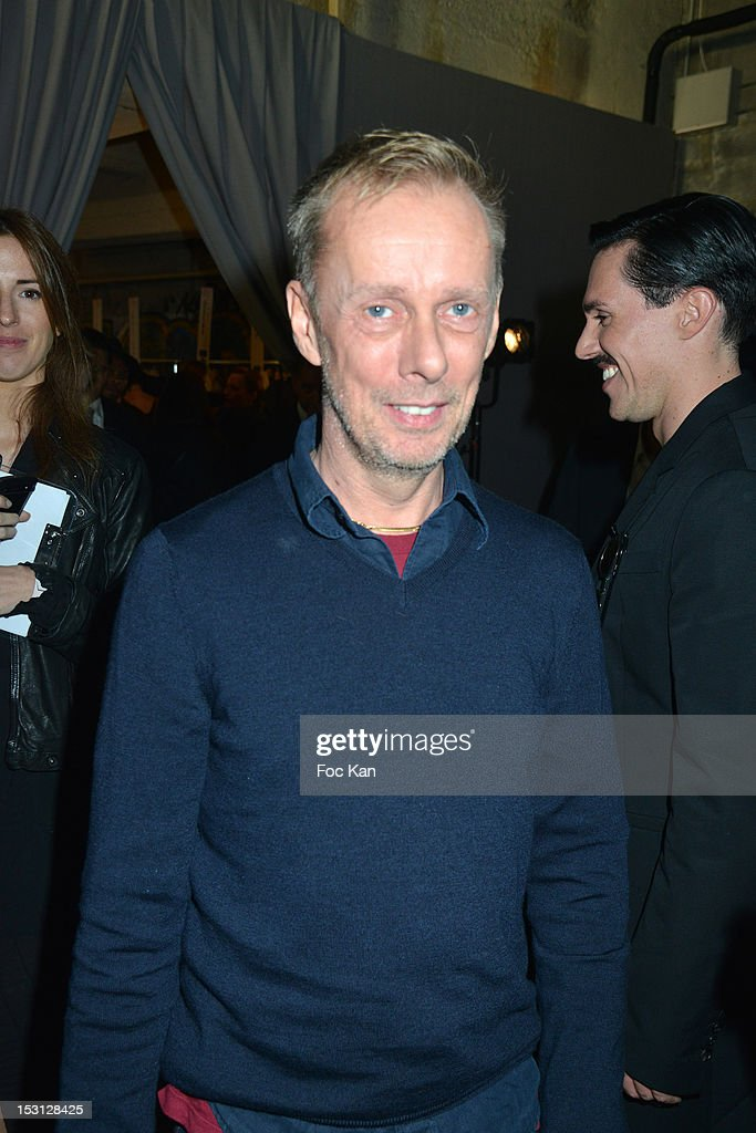 Fashion designer Bill Gaytten poses during the John Galliano: Front Row - Paris Fashion Week Womenswear Spring / Summer 2013 at Docks en Seine on September 30, 2012 in Paris, France.