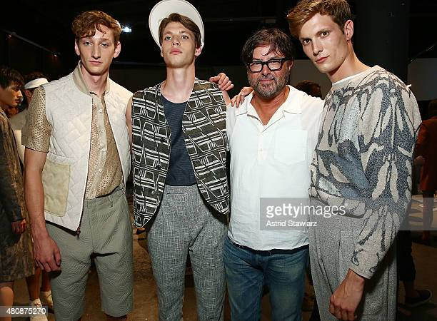 Fashion designer Billy Reid poses with models backstage at Billy Reid New York Fashion Week Men's S/S 2016at Art Beam on July 15 2015 in New York City