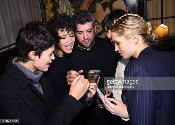 Fashion designer Brandon Maxwell poses with models during the after party for the Brandon Maxwell A/W 2016 fashion show during New York Fashion Week...