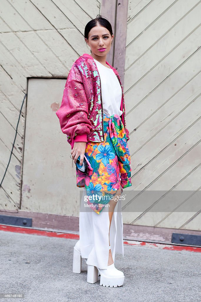 Fashion Designer Brit Day wears her own design dress and jacket Jeffrey Campbell shoes and Discount Universe clutch at MercedesBenz Fashion Week...