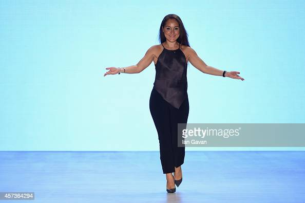 Fashion designer Burce Bekrek acknowledges the applause of the audience after the Burce Bekrek show during Mercedes Benz Fashion Week Istanbul SS15...