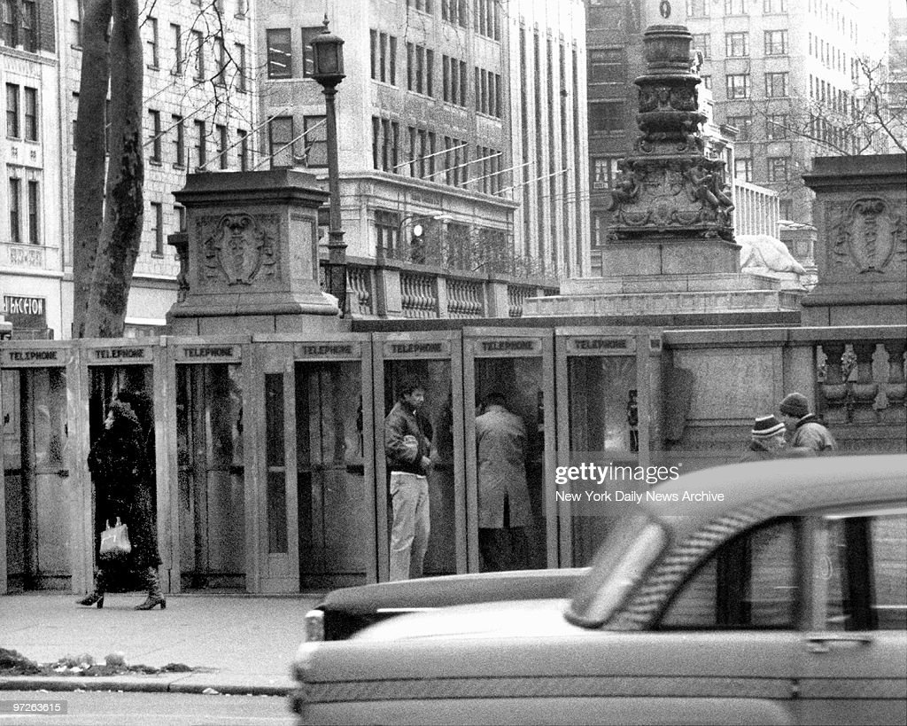 Fashion designer Calvin Klein has a tense wait in a telephone booth on 42nd St. at Fifth Ave. for a call from the kidnapper of his daughter, Marci, 11. The bag under his arm contains $100,000 ransom. She was released later in the day by the kidnappers. ,