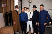Fashion designer Carlos Campos poses with models during his New York Fashion Week Men's Fall/Winter 2016 presentation at Skylight at Clarkson Sq on...
