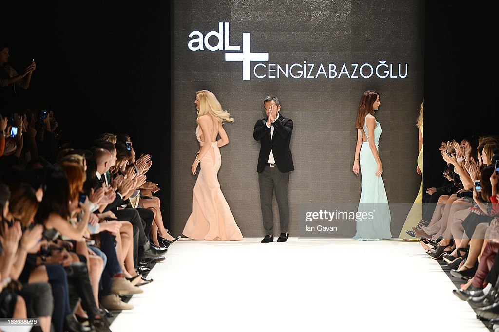 Fashion designer Cengiz Abazoglu (C) and models walk the runway at the ADL & Cengiz Abazoglu show during Mercedes-Benz Fashion Week Istanbul s/s 2014 presented by American Express on October 8, 2013 in Istanbul, Turkey.
