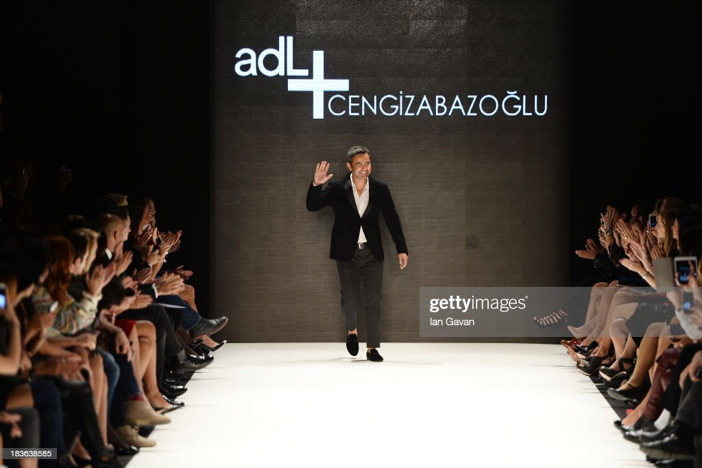 Fashion designer Cengiz Abazoglu walks the runway at the ADL & Cengiz Abazoglu show during Mercedes-Benz Fashion Week Istanbul s/s 2014 presented by American Express on October 8, 2013 in Istanbul, Turkey.