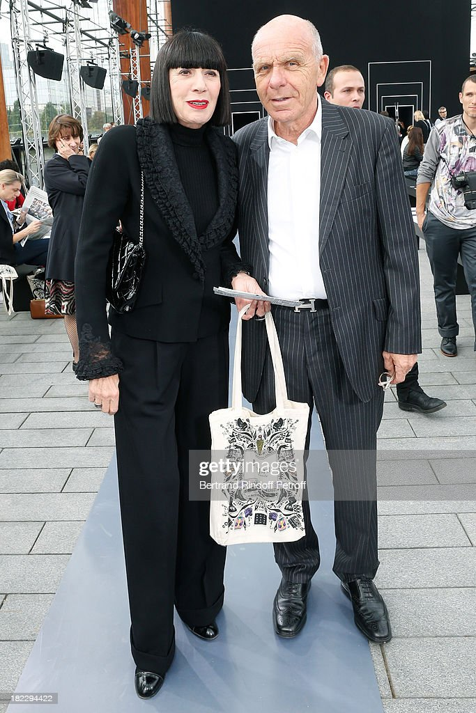 Fashion Designer Chantal Thomass and her husband Michel Fabian attend Maxime Simoens show as part of the Paris Fashion Week Womenswear Spring/Summer 2014, held at Orangerie du parc Andre Citroen on September 29, 2013 in Paris, France.