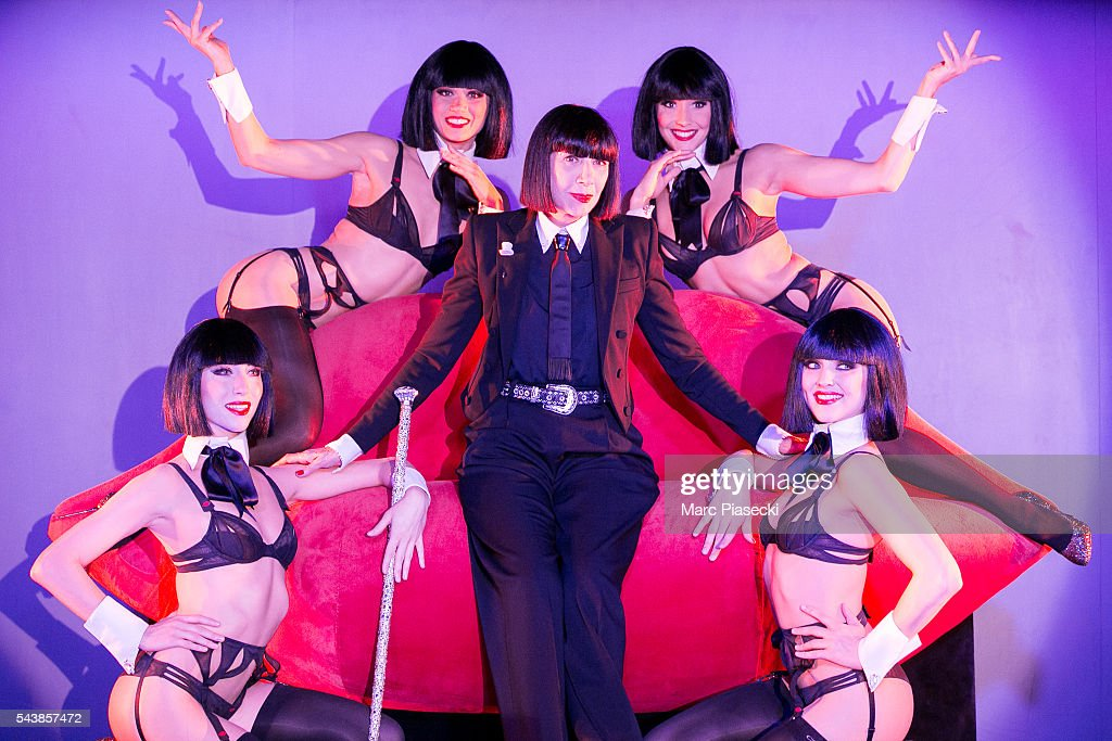 Fashion designer Chantal Thomass (C) poses with the 'Crazy Girls' as the new collaborator for the next show 'Dessous Dessus' at Le Crazy Horse on June 30, 2016 in Paris, France.