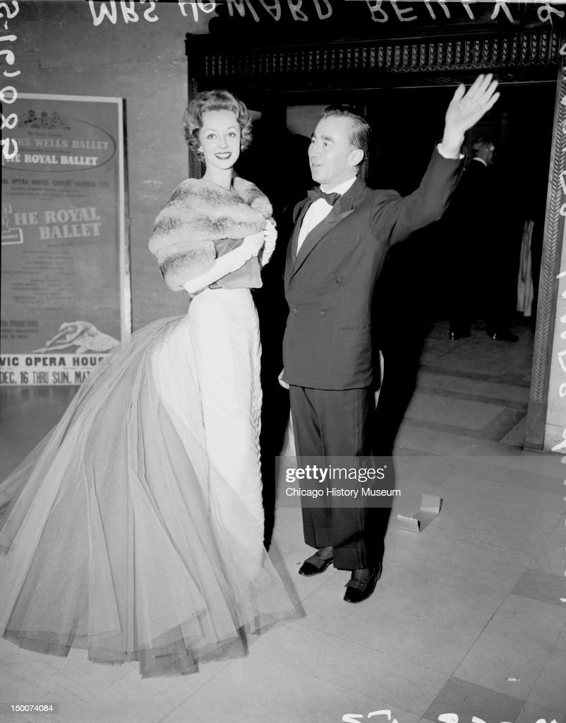 Fashion designer Charles James with Mrs Howard Reilly wearing James gown December 17 1957