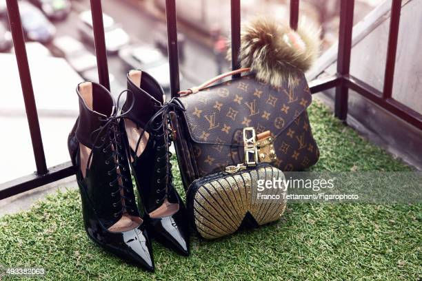 109232008 Fashion designer Chiara Ferragni's style inspirations are photographed for Madame Figaro on February 28 2014 in Paris France Boots bag bag...