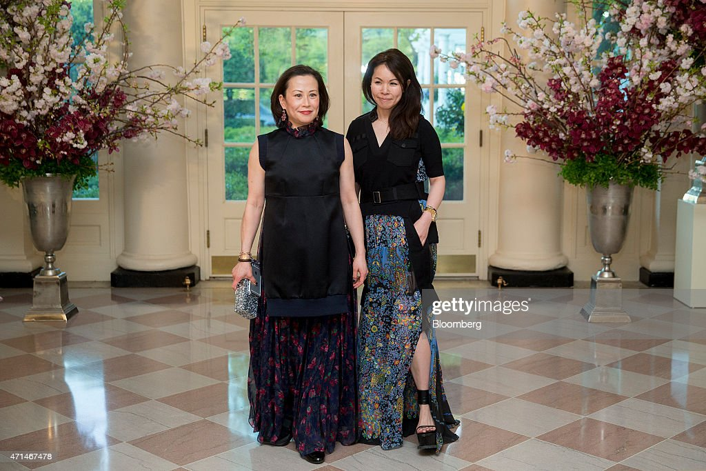 Fashion designer Chitose Abe, right, and Miki Higasa arrive at a state dinner hosted by U.S. President Barack Obama and U.S. First Lady Michelle Obama in honor of Japan's Prime Minister Shinzo Abe at the White House in Washington, D.C., U.S., on Tuesday, April 28, 2015. Prime Minister Shinzo Abe goes before the U.S. Congress on Wednesday to present Japan as a stalwart ally that's willing to play a bigger military role in Asia, a message likely to be embraced in Washington and greeted with suspicion in Seoul and Beijing. Photographer: Andrew Harrer/Bloomberg via Getty Images