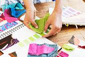 fashion designer choosing colors for fabric.