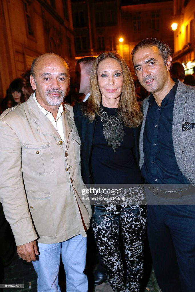 Fashion designer <a gi-track='captionPersonalityLinkClicked' href=/galleries/search?phrase=Christian+Louboutin+-+Fashion+Designer&family=editorial&specificpeople=4644509 ng-click='$event.stopPropagation()'>Christian Louboutin</a> with <a gi-track='captionPersonalityLinkClicked' href=/galleries/search?phrase=Marisa+Berenson&family=editorial&specificpeople=206844 ng-click='$event.stopPropagation()'>Marisa Berenson</a> and Jean-Michel Simonian attend the 'Opium' movie premiere, held at Cinema Saint Germain in Paris on September 27, 2013 in Paris, France.