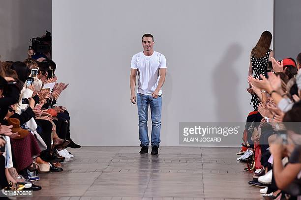 Fashion designer Christian Wijnants acknowledges the audience at the end of the 2017 Spring/Summer readytowear collection fashion show on September...