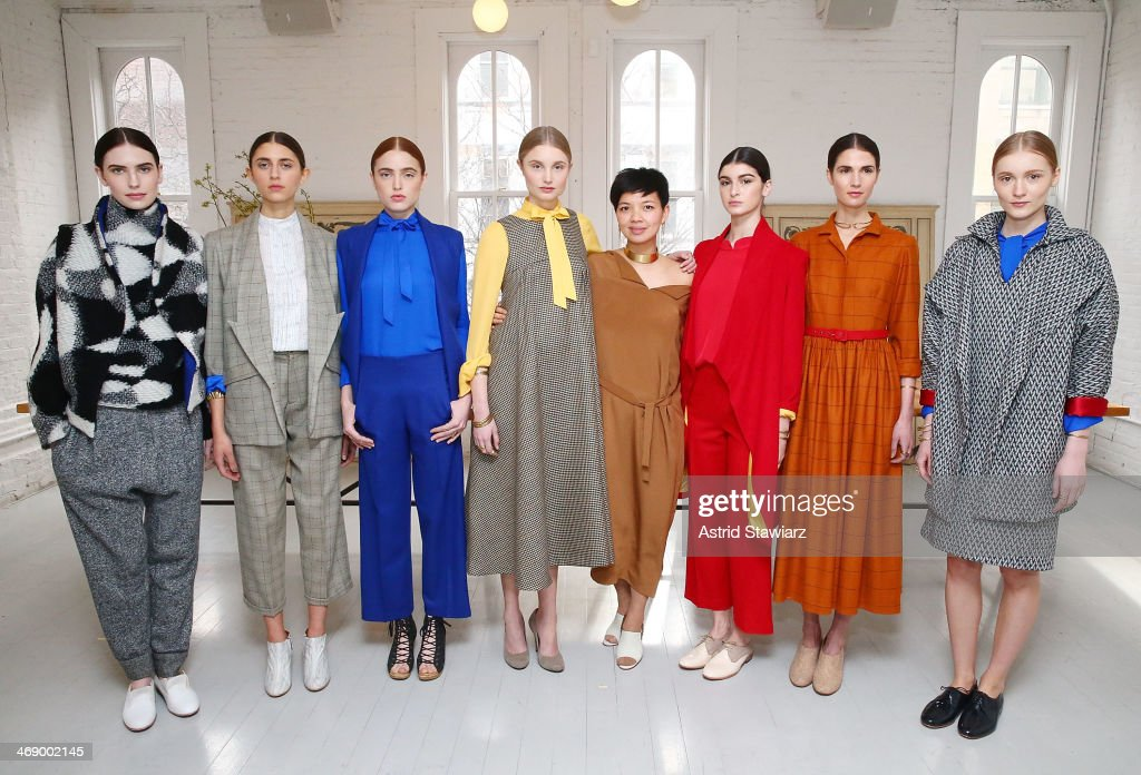 Fashion designer Christine Alcalay (4th from right) poses for photos at the Christine Alcalay presentation during Mercedes-Benz Fashion Week Fall 2014 on February 12, 2014 in New York City.