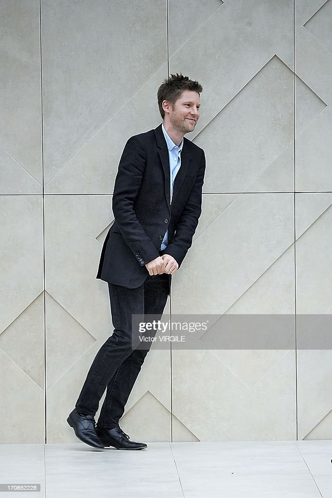 Fashion designer Christopher Bailey walks the runway at the Burberry Prorsum show at the London Collections: MEN Spring Summer 2014 at Kensington Gardens on June 18, 2013 in London, England.