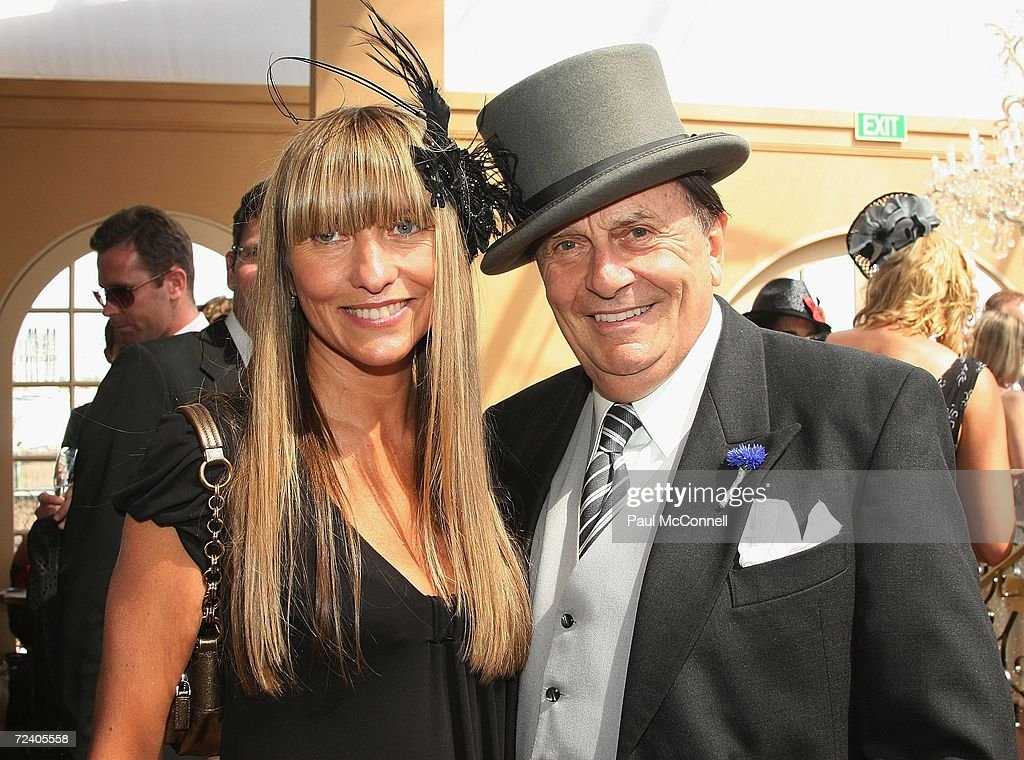 Fashion Designer Collette Dinnigan and actor Barry Humphries attend the AAMI Victoria Derby Day part of the four day Melbourne Cup Carnival at...