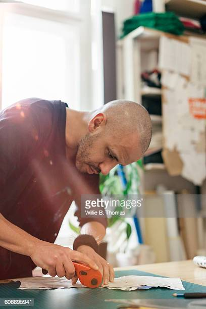 Fashion Designer concentrating on his work