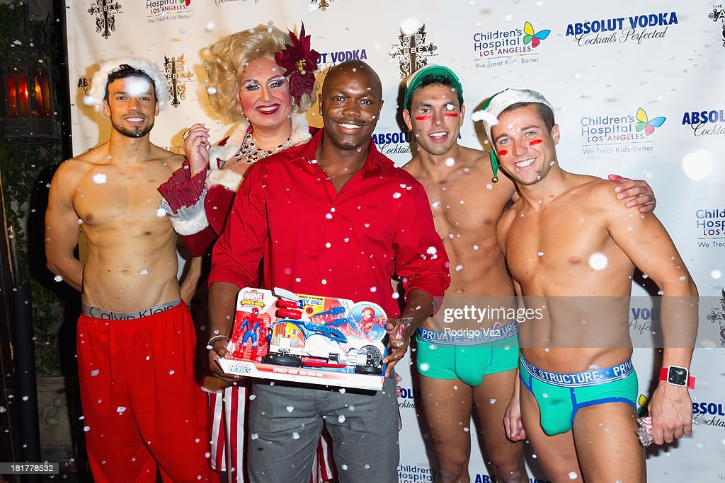 Fashion designer Damarcus Morton (C) attends The Abbey's 8th annual Christmas In September Event benefiting The Children's Hospital Los Angeles at The Abbey on September 24, 2013 in West Hollywood, California.