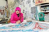 Fashion designer Dame Zandra Rhodes is photographed at her studio for Hello magazine on February 10 2015 in London England