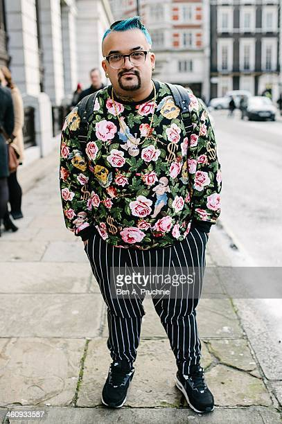 Fashion designer David poses wearing Versace earrings Victoria Richards sweater with Rehash trousers at the Matthew Miller catwalk presentation...